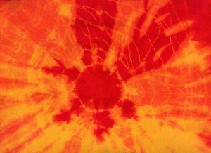 Vyvazovaná batika oranžovou a žlutou
